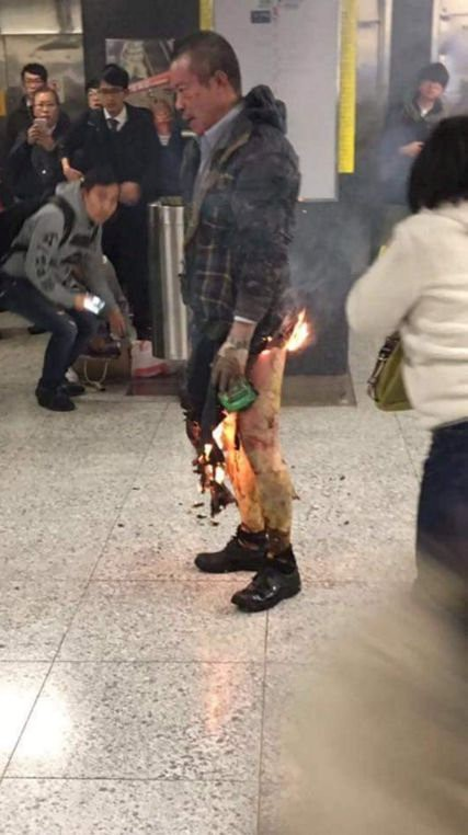 A man, whom police believe to have set himself alight, is seen inside a subway station in Hong Kong, China February 10, 2017. Social Media/@GastronomicNerd/via Reuters TVATTENTION EDITORS - THIS IMAGE WAS PROVIDED BY A THIRD PARTY. EDITORIAL USE ONLY. NO RESALES. NO ARCHIVE. MANDATORY CREDIT. MUST ON SCREEN COURTESY @GastronomicNerd. NO USE AFTER MARCH 12 2017. PLEASE REMOVE FROM WEBSITES AFTER MARCH 12, 2017.      TPX IMAGES OF THE DAY